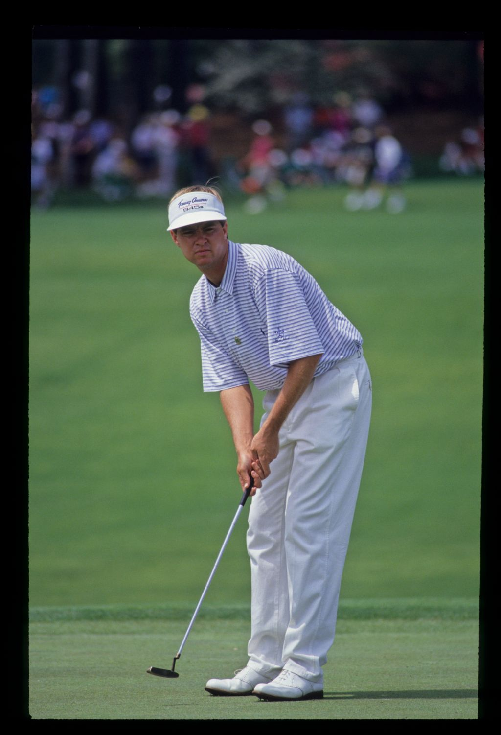 Davis Love III putting during the 1992 Masters
