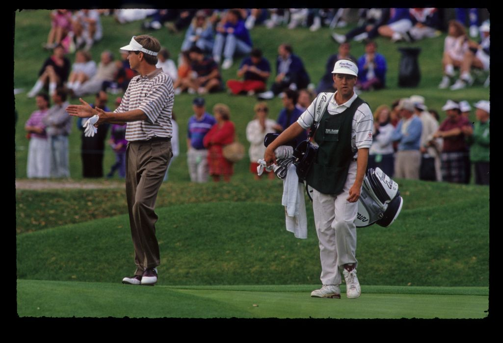 Davis Love III gesturing to the crowd on his way to winning the 1992 TPC