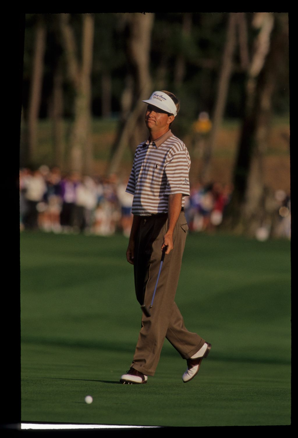 Davis Love III reacting to a putt on the way to winning the 1992 TPC