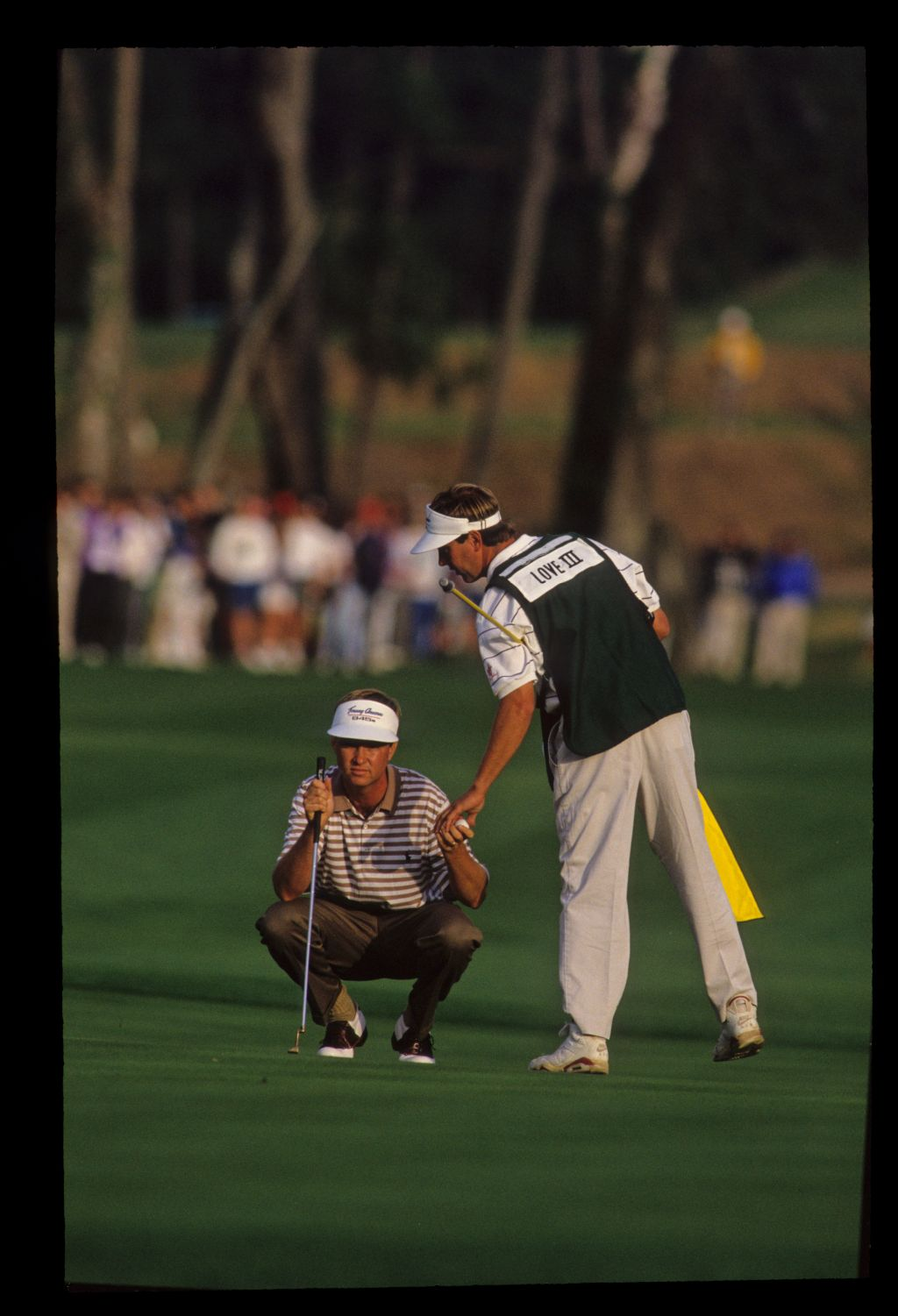 Davis Love III and his caddie lining up a putt on his way to winning the 1992 TPC