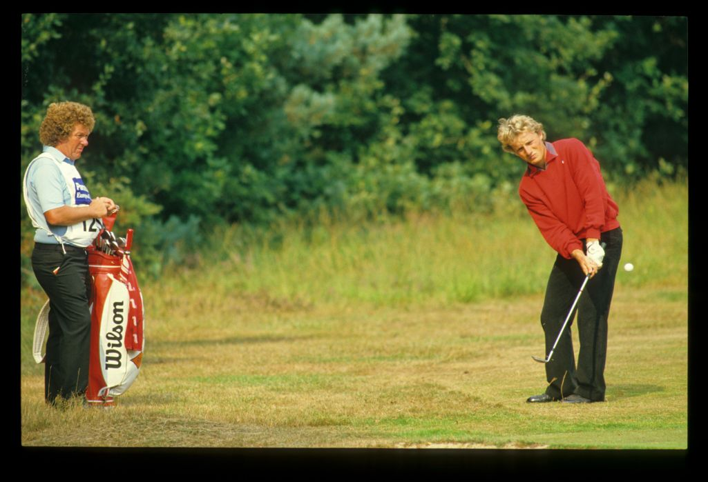 Bernhard Langer and his caddie playing from the rough during the 1984 Panasonic Euroepean Open