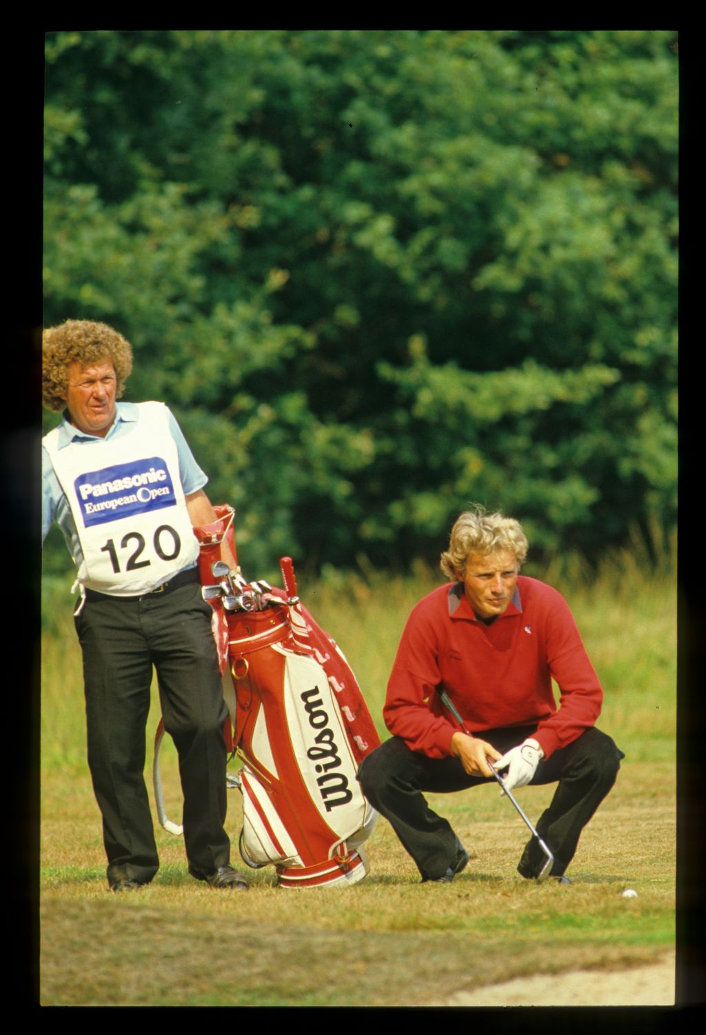 Bernhard Langer and his caddie considering a shot from the rough during the 1984 Panasonic Euroepean Open