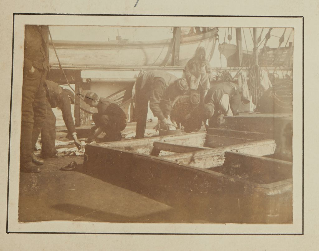 [Crew and Inuit working onboard of the ship]
