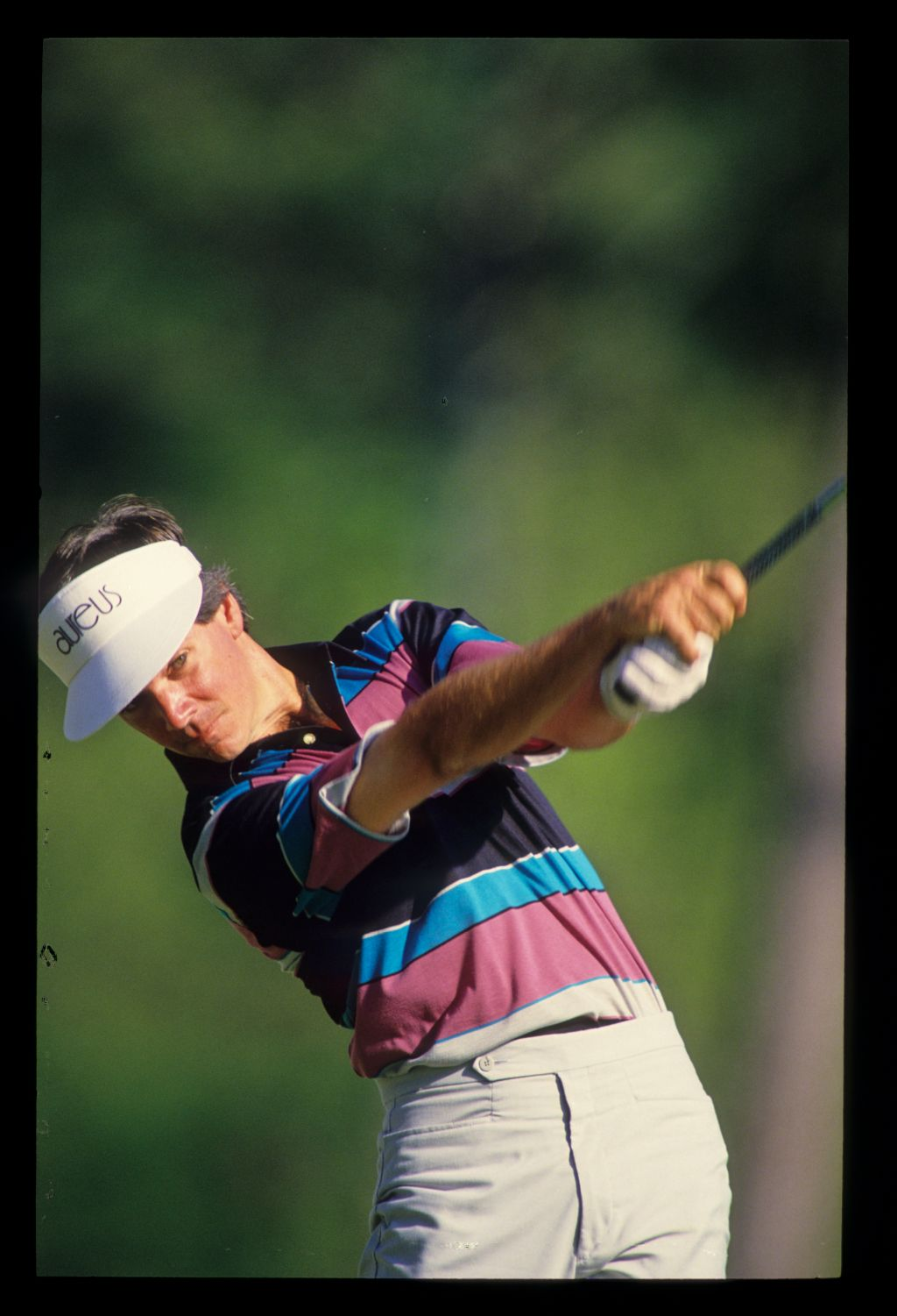 Larry Mize extending through the ball on his way to winning the 1987 Masters