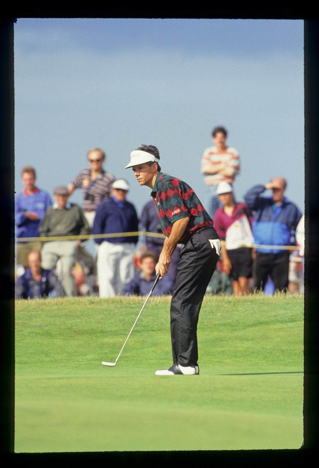 Larry Mize putting during the 1993 Open Championship