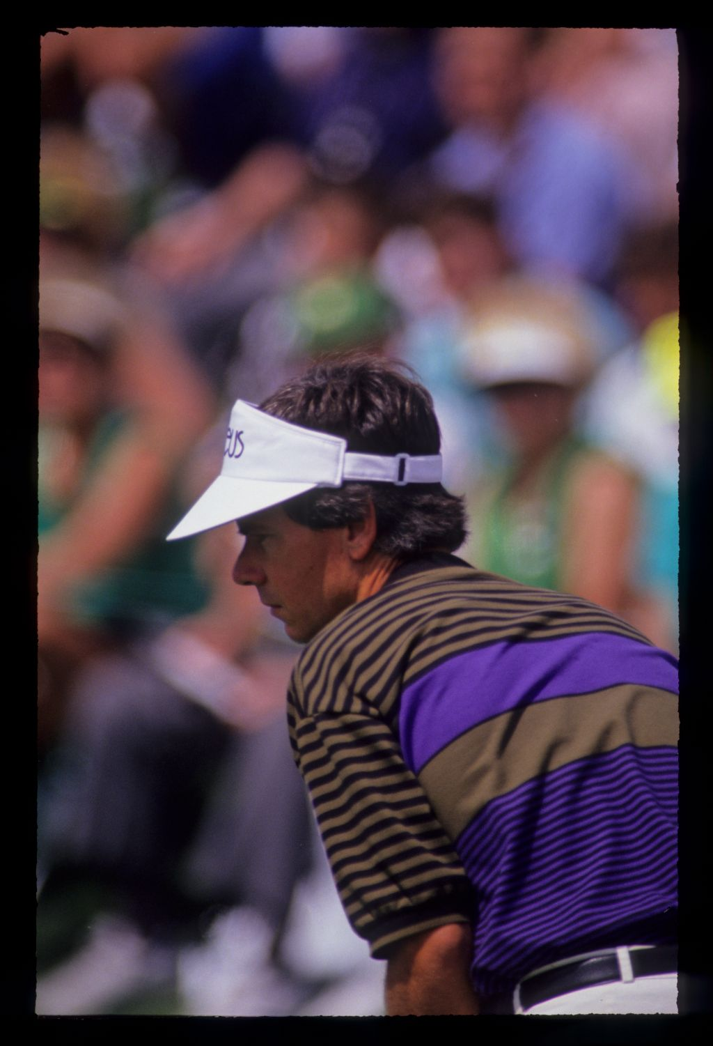 Larry Mize willing his putt to drop during the 1991 Masters