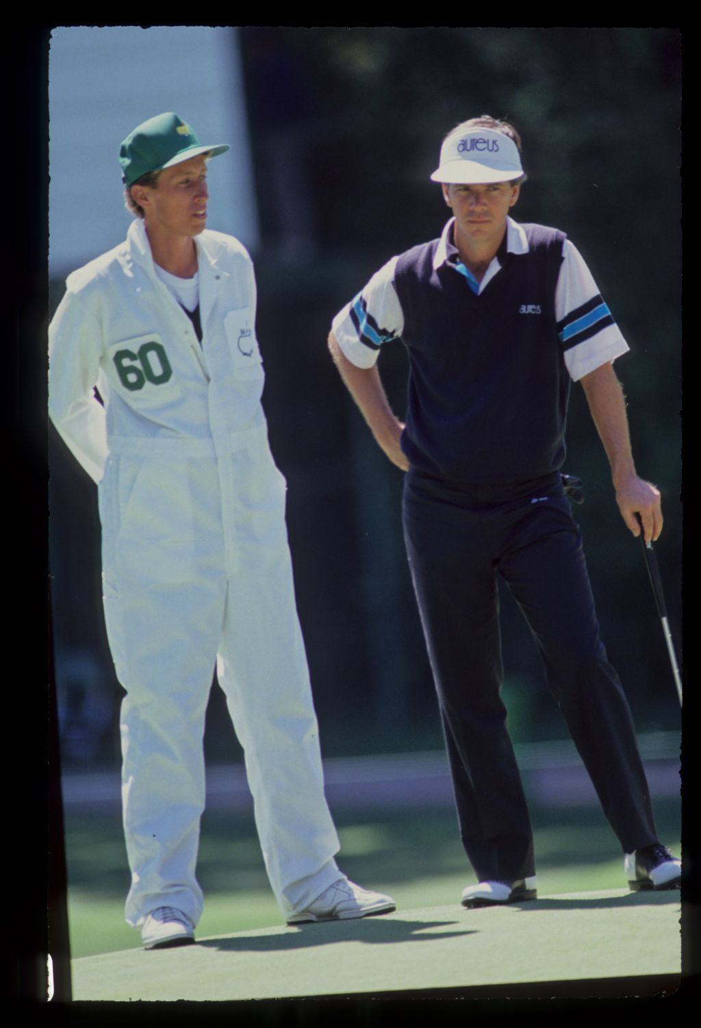 Larry Mize and his caddie on the green during the 1990 Masters