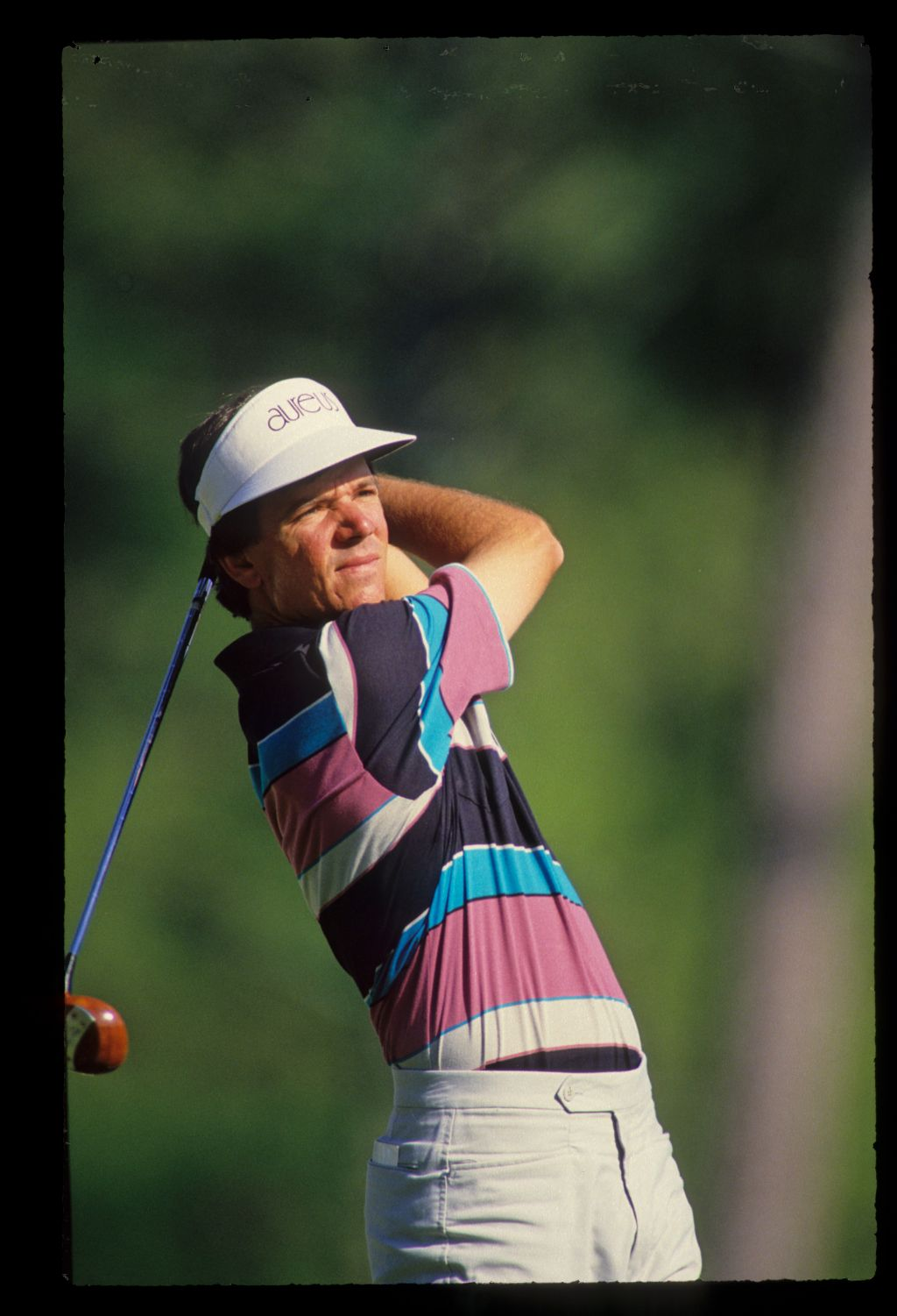 Larry Mize hands high on the tee on his way to winning the 1987 Masters