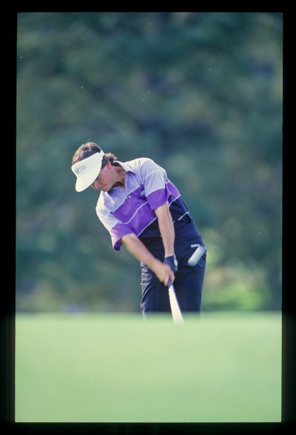 Larry Mize staying down through the ball on his way to winning the 1987 Masters
