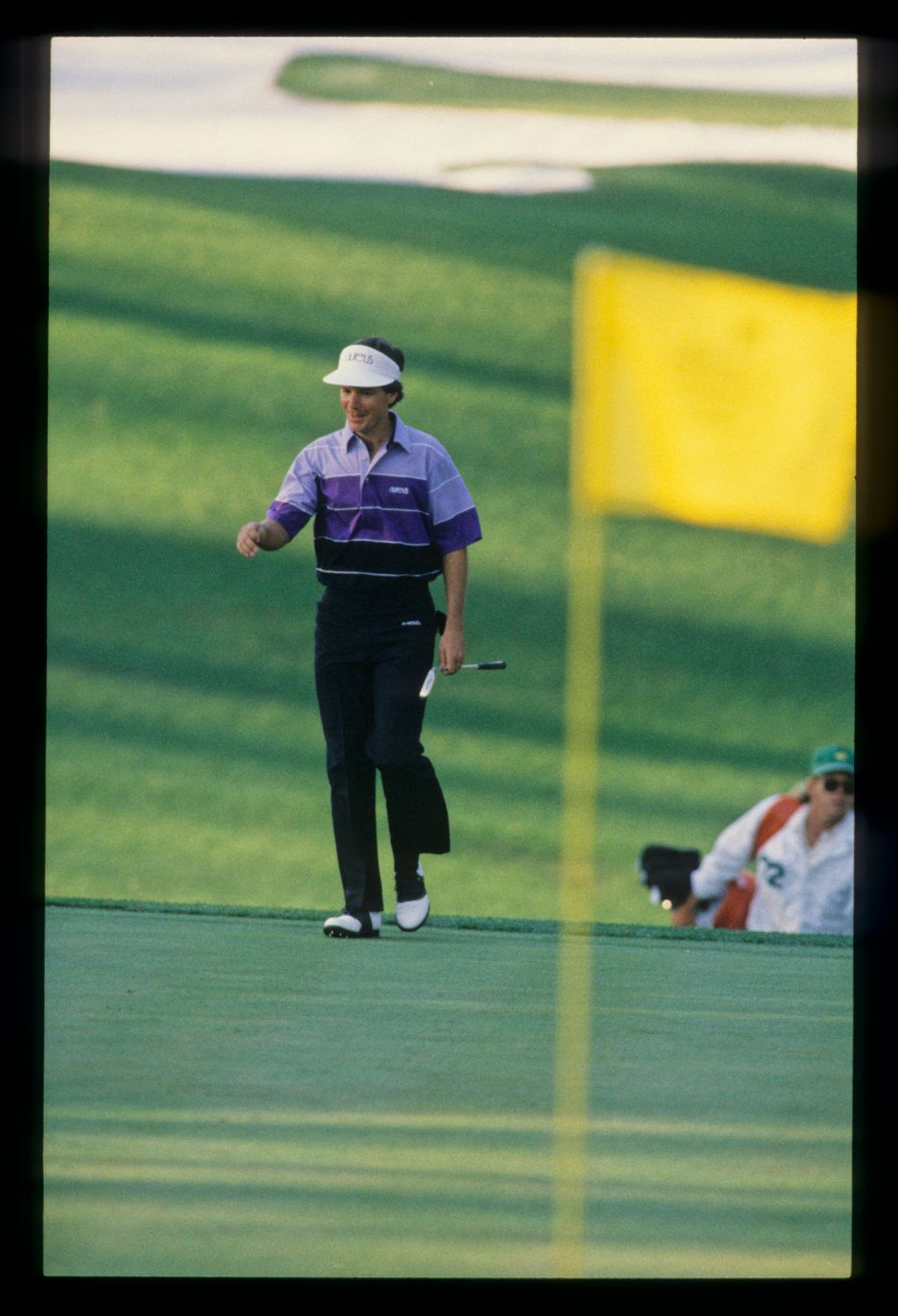 Larry Mize acknowledging the crowd while approaching the green on his way to winning the 1987 Masters