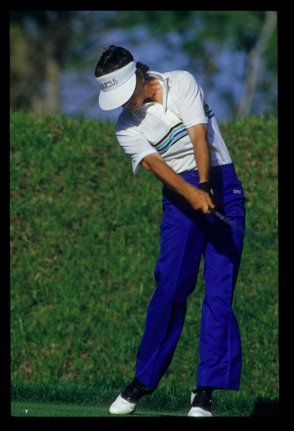Larry Mize staying down through the ball on the tee during the 1986 TPC