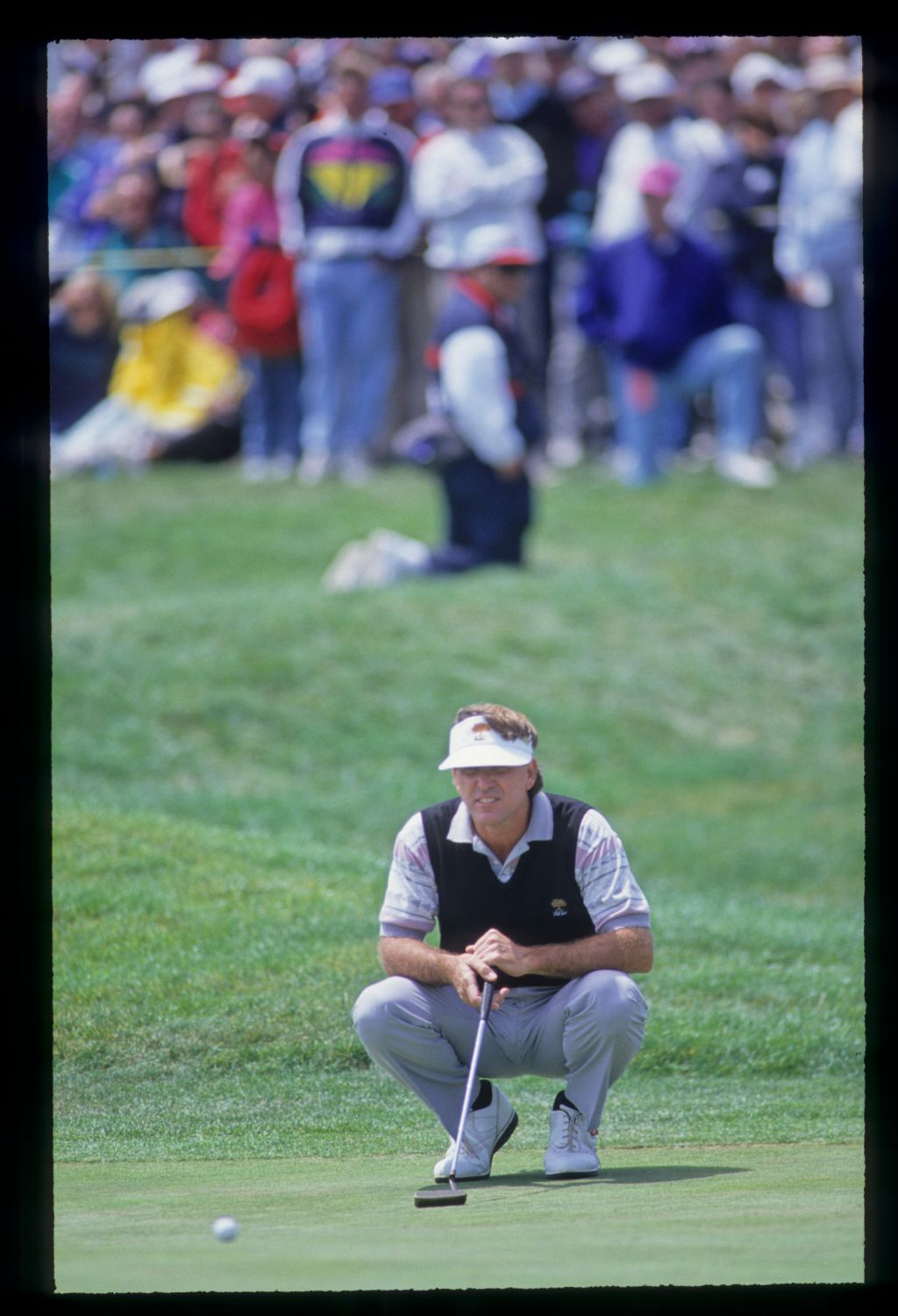 Gil Morgan lining up a putt during the 1992 US Open