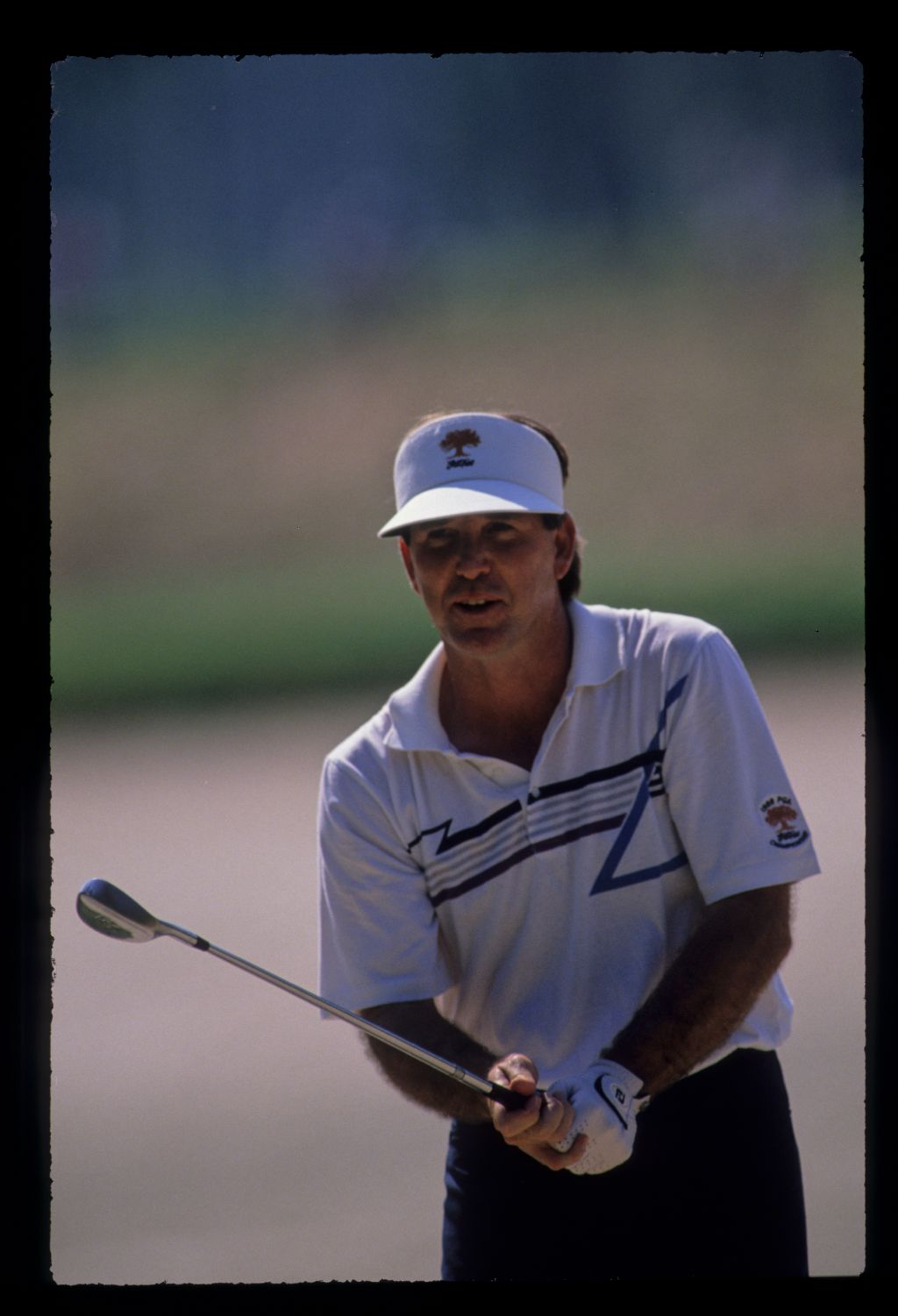Gil Morgan playing from a bunker during the 1989 TPC
