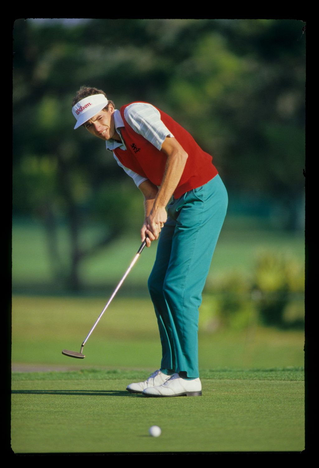Philip Parkin watching a putt closely during the 1987 Hertz Bay Hill Classic