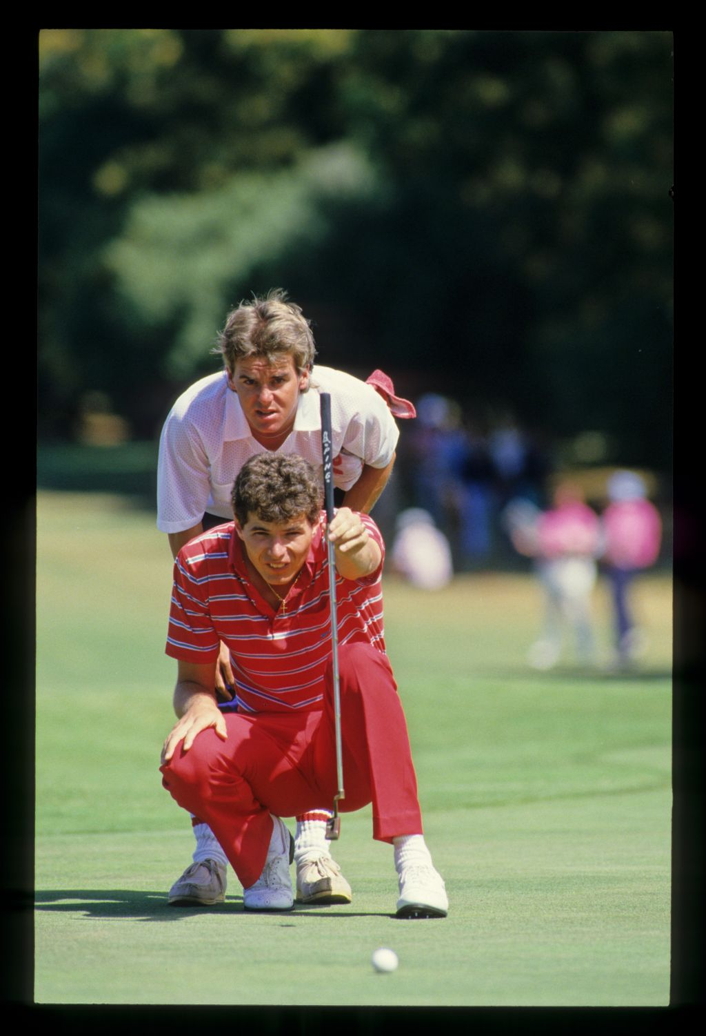 Philip Parkin and his caddie lining up a putt during the 1986 Australian Masters