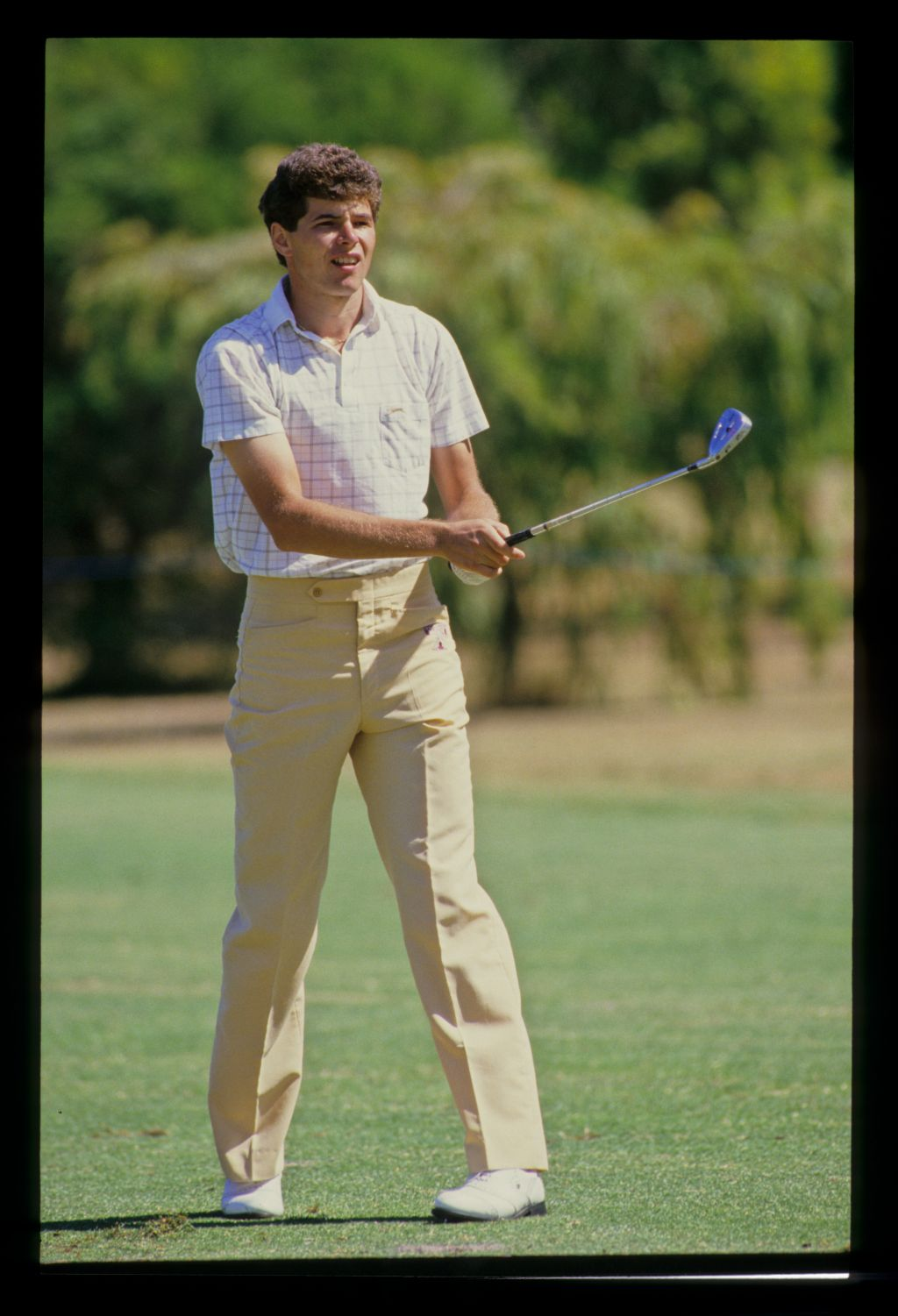 Philip Parkin watching a shot closely during the 1986 Australian Masters