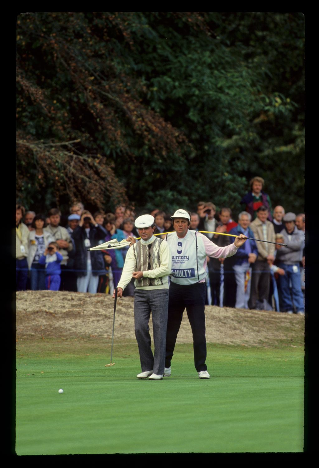 Mark McNulty and his caddie lining up a putt on his way to second place during the 1990 Suntory World Matchplay