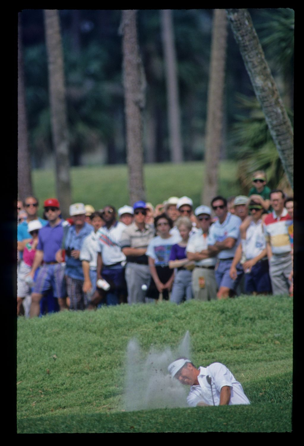 Mark O'Meara splashing from a bunker on his way to fifth place during the 1993 TPC