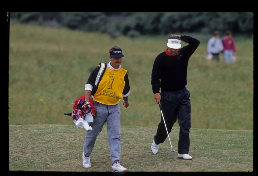 Mark O'Meara and his caddie smiling during the 1992 Open Championship