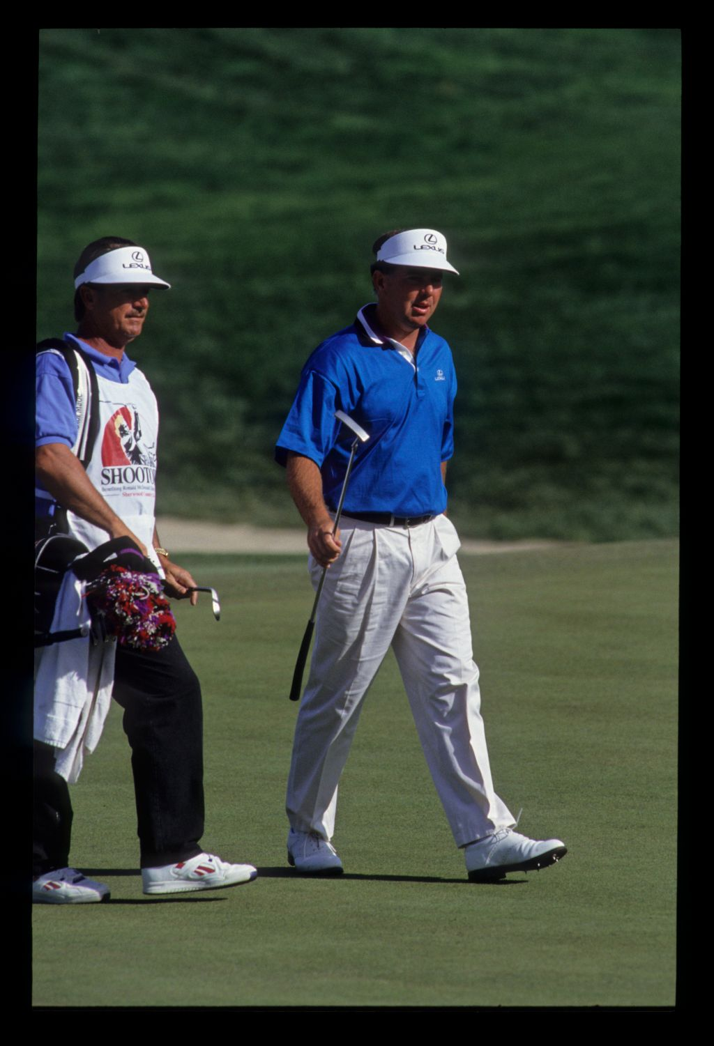 Mark O'Meara and his caddie on the green during the 1991 Shark Shootout