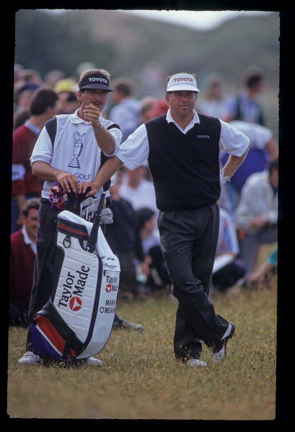 Mark O'Meara and his caddie considering their options in the rough during the 1991 Open Championship