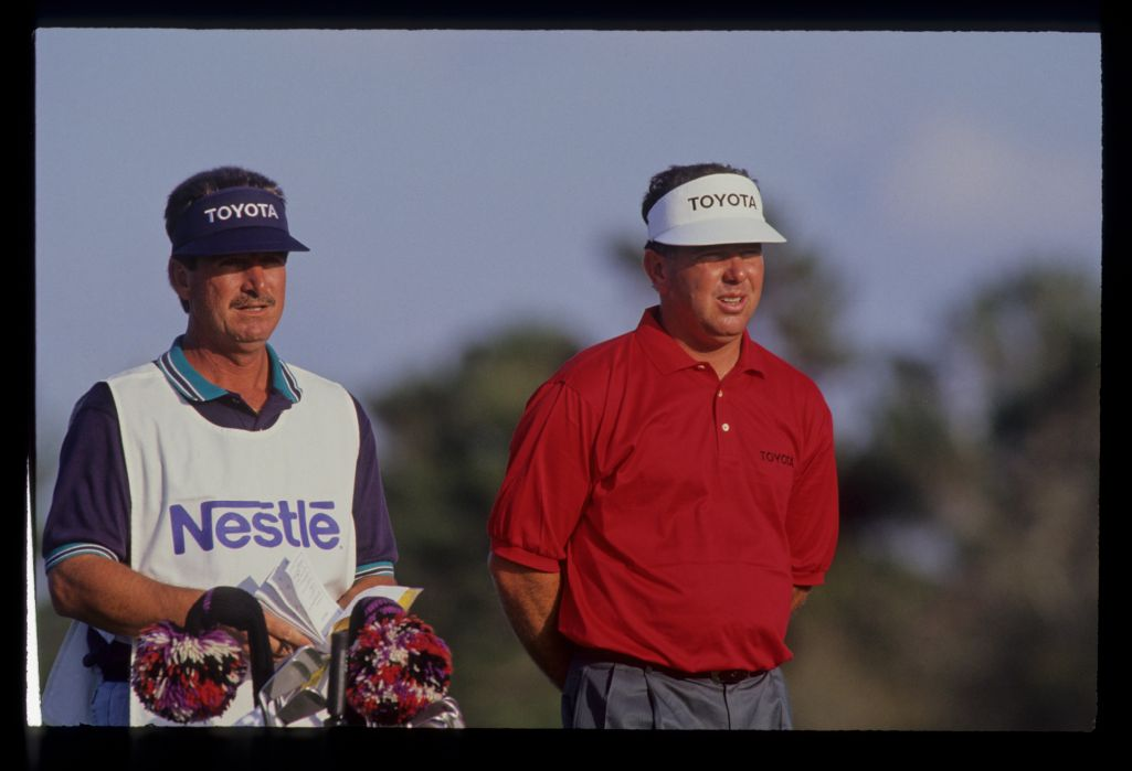 Mark O'Meara and his caddie considering their options during the 1990 Nestle Invitational