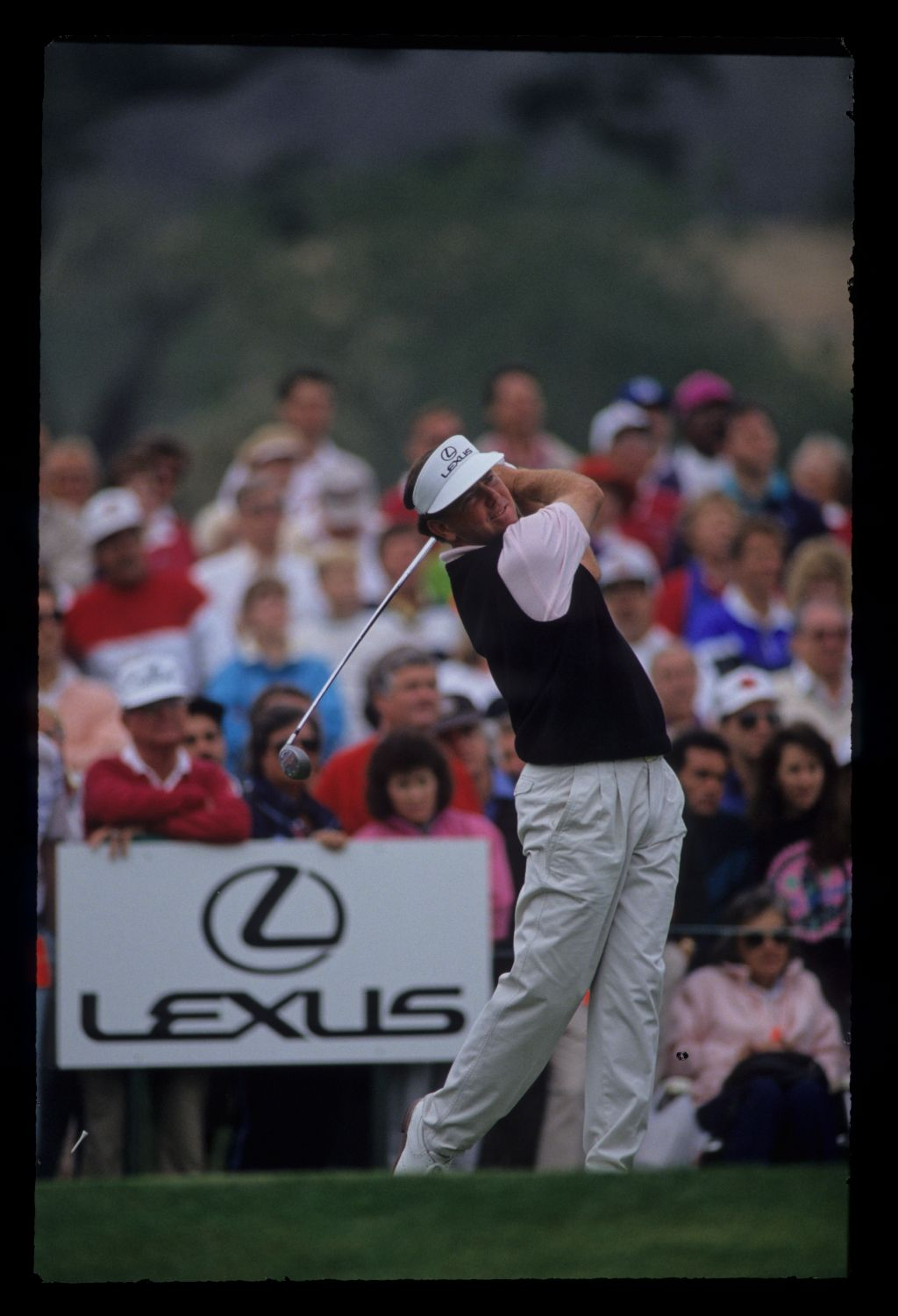 Mark O'Meara following through on the tee during the 1991 Shark Shootout