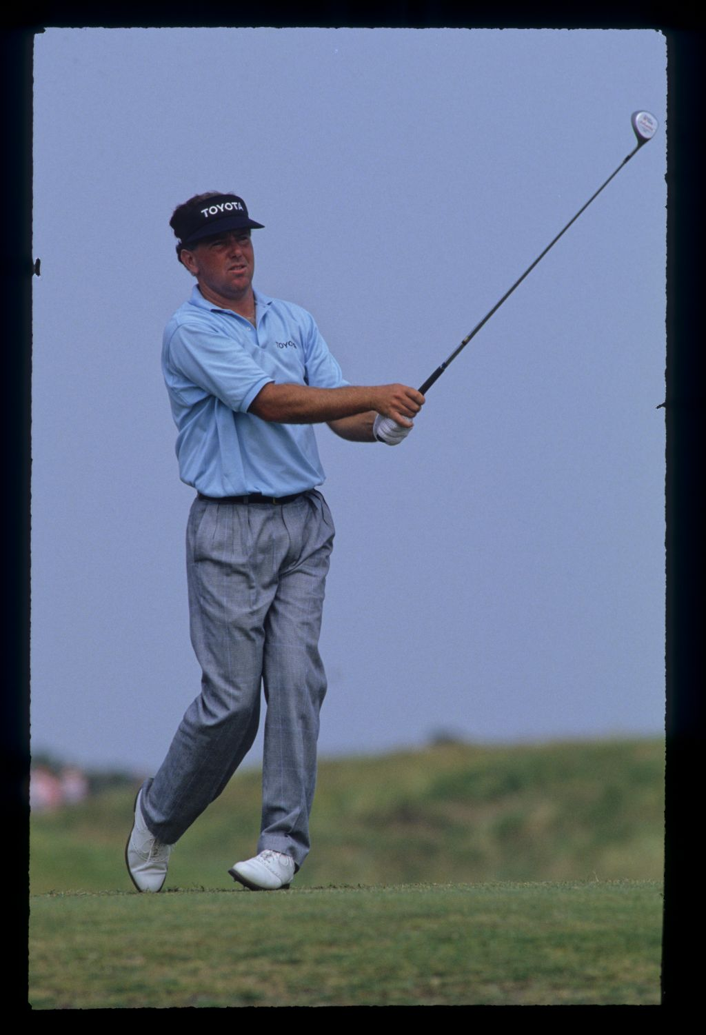 Mark O'Meara watching closely the tee during the 1990 Open Championship