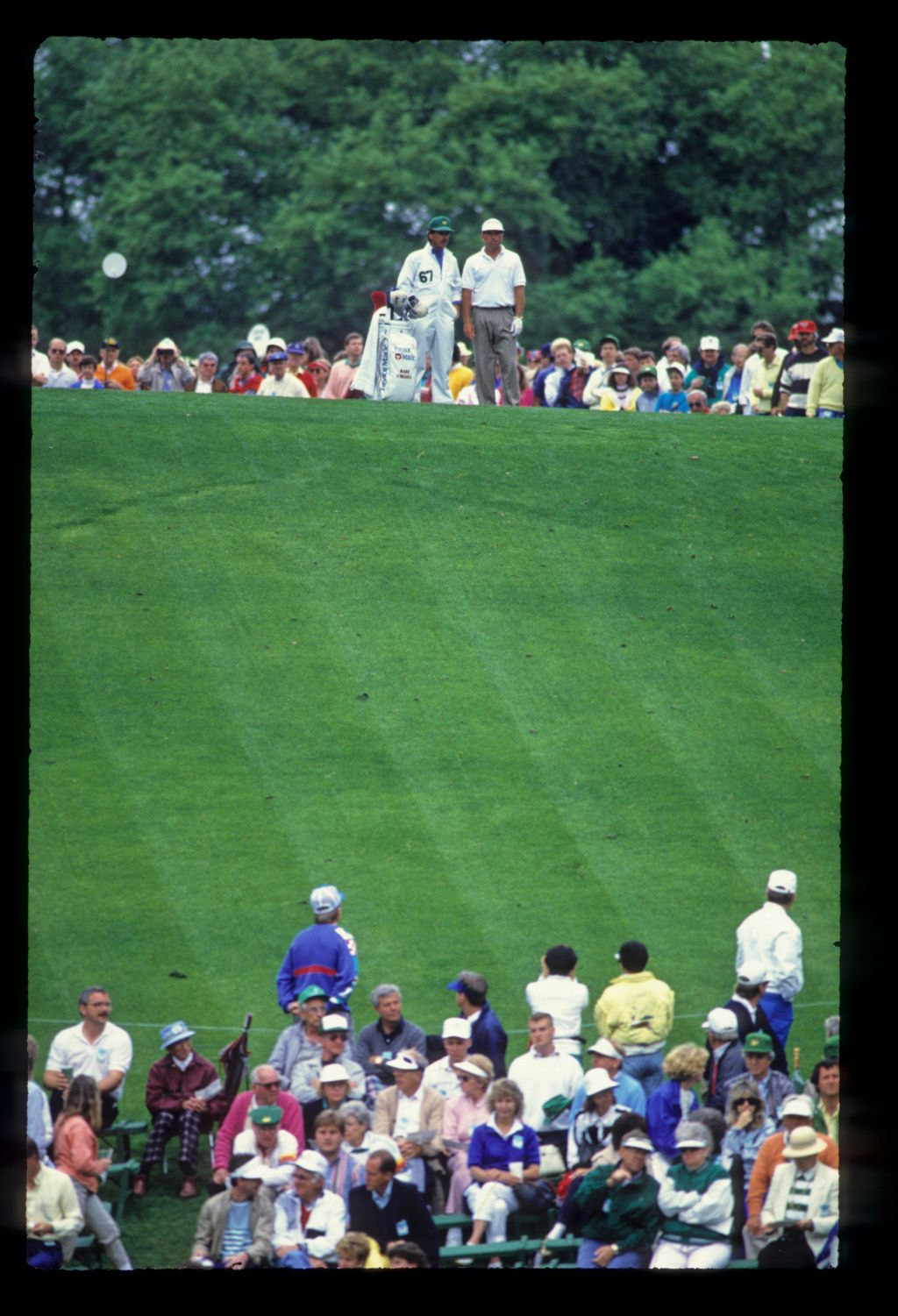 Mark O'Meara and his caddie on the tee during the 1989 Masters
