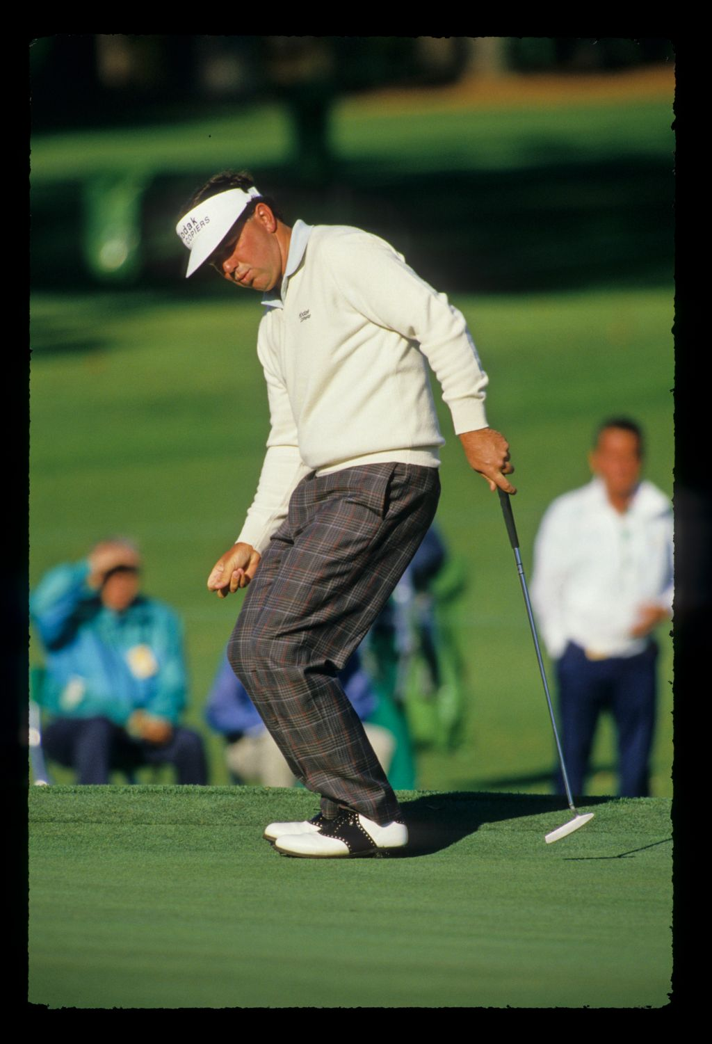 Mark O'Meara reacting to a putt during the 1988 Masters