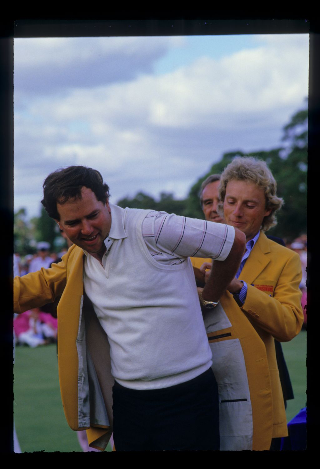 Mark O'Meara being helped into his golden jacket after winning the 1986 Australian Masters