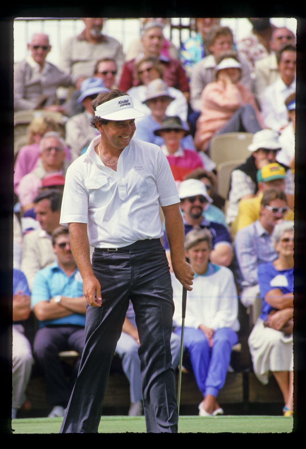 Mark O'Meara smiling after a putt on his way to winning the 1986 Australian Masters