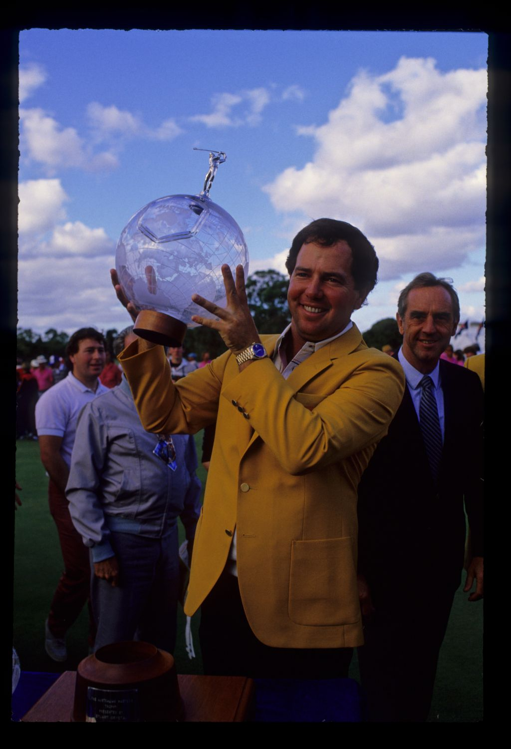 Mark O'Meara holding the trophy aloft after winning the 1986 Australian Masters
