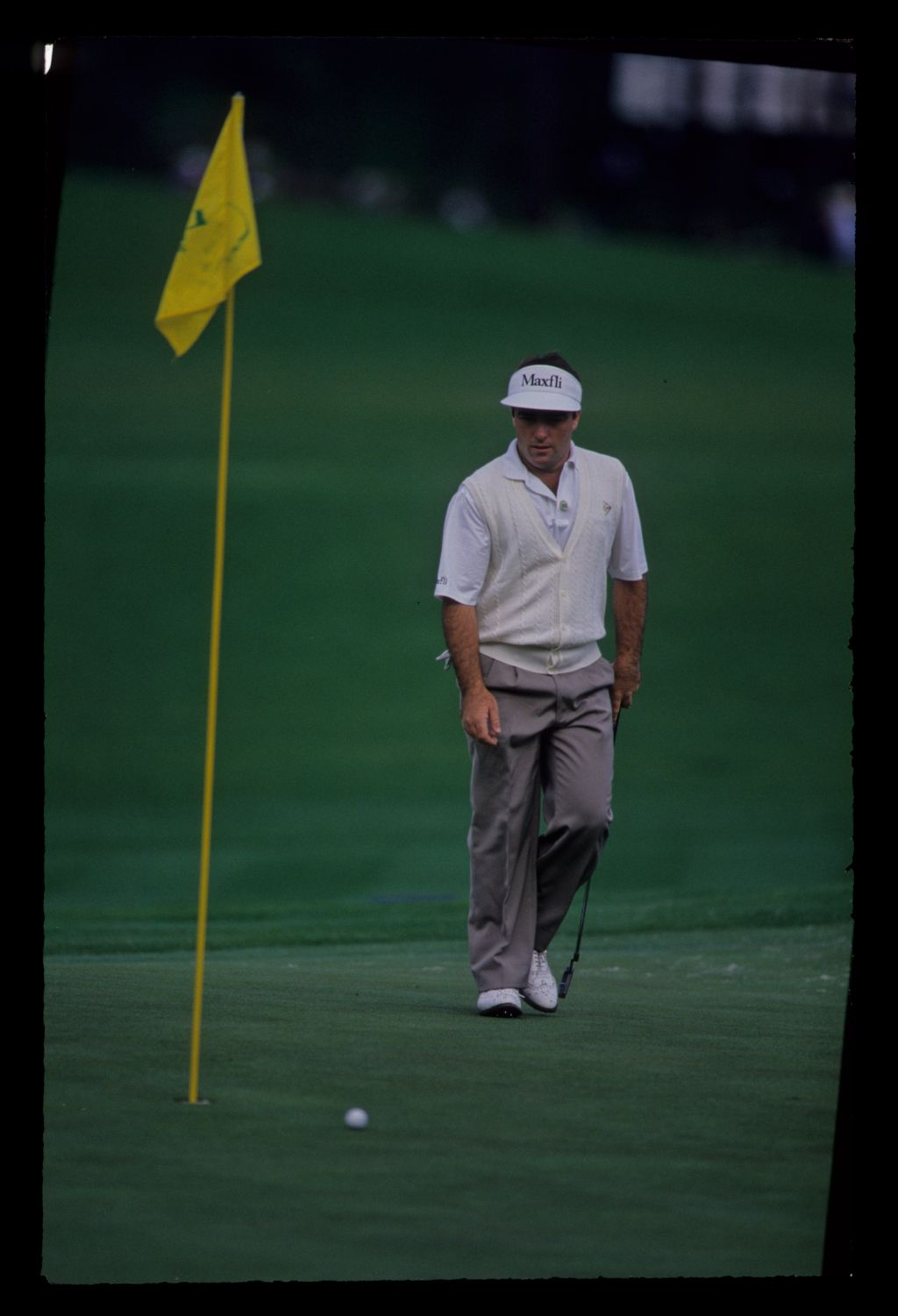 Craig Parry walking after a putt during the 1992 Masters