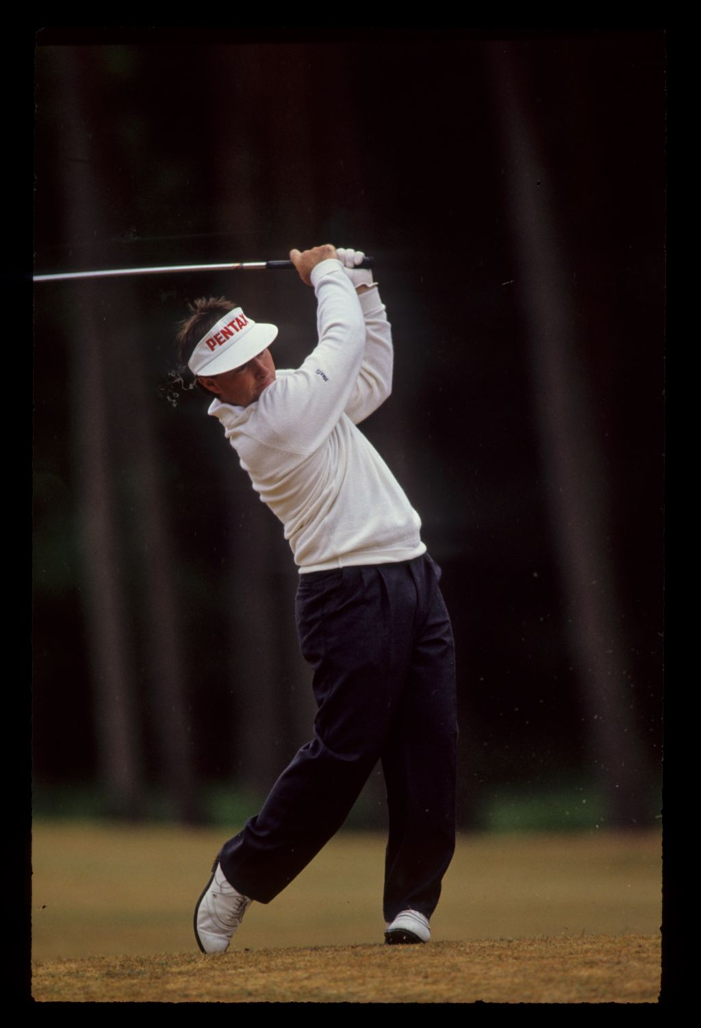 Craig Parry hands high on his way to eighth place during the 1990 Dunhill British Masters