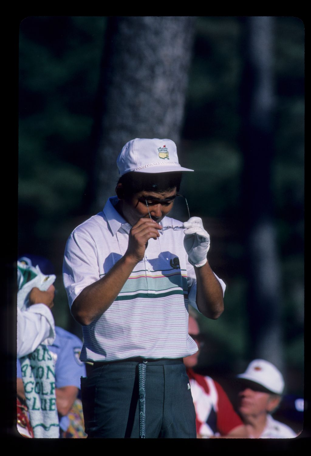 Tommy Nakajima adjusting his glasses on his way to eighth place during the 1986 Masters