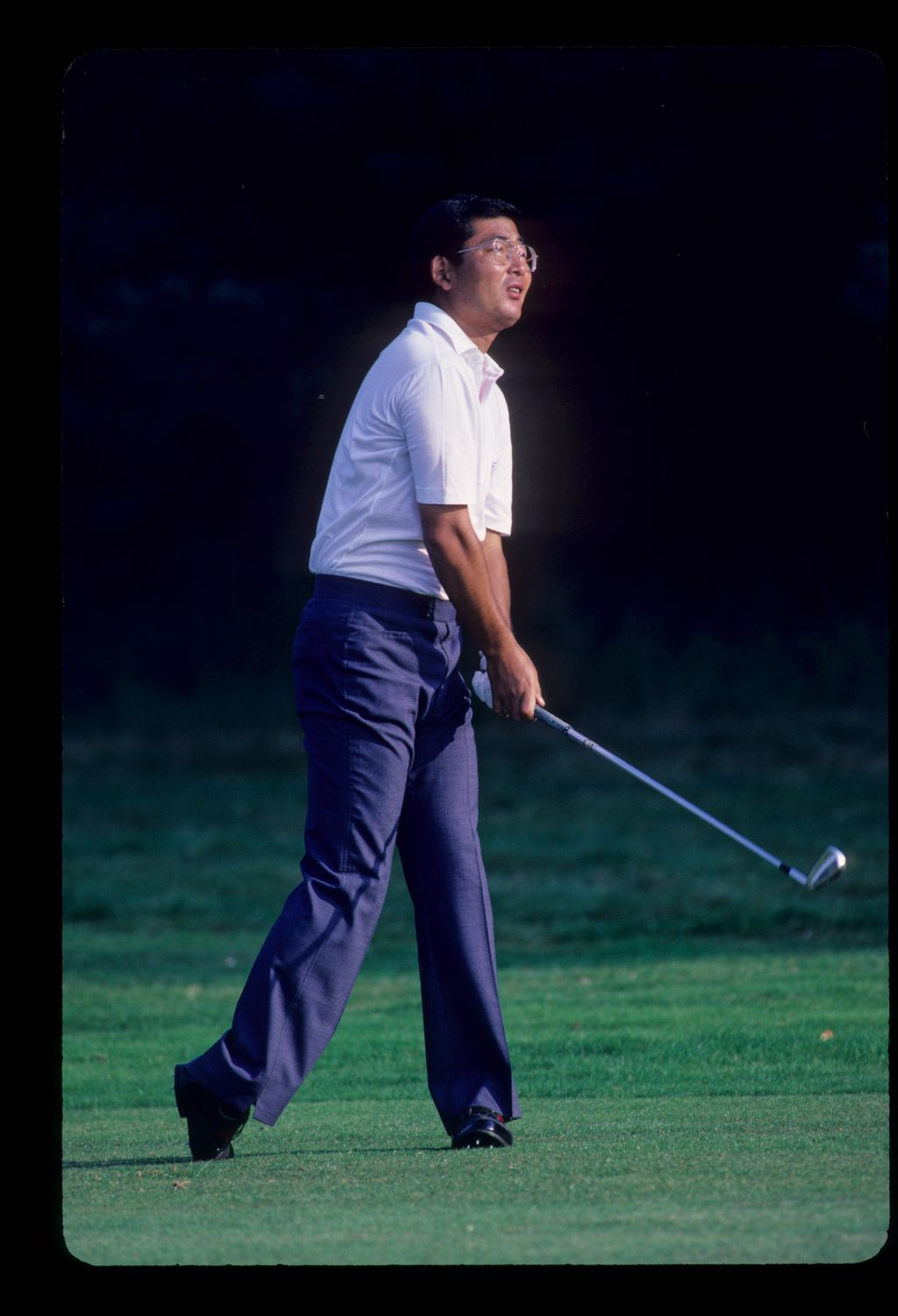 Tommy Nakajima watching closely from the fairway during the 1985 Suntory World Matchplay