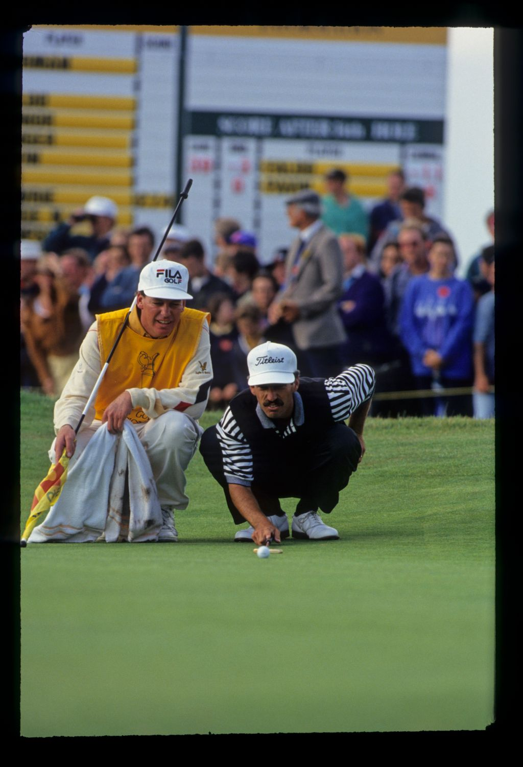 Corey Pavin and his caddie lining up a putt on his way to fourth place during the 1993 Open Championship
