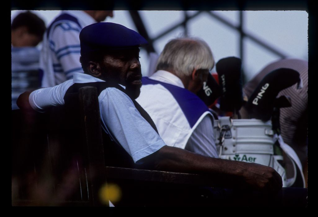 Calvin Peete sitting on a bench during the 1983 USPGA