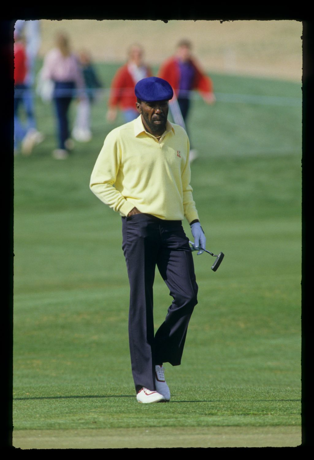 Calvin Peete looking thoughtful while he approaches the green during the 1987 Phoenix Open