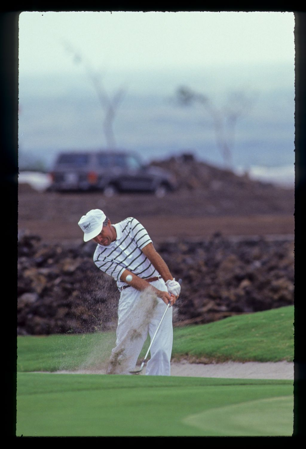 Gary Player splashing from a bunker during the 1990 Senior Skins Game