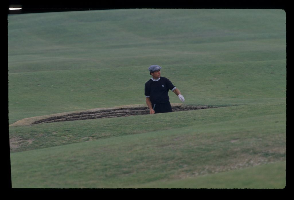 Gary Player waist deep in a bunker during the 1990 Open Championship