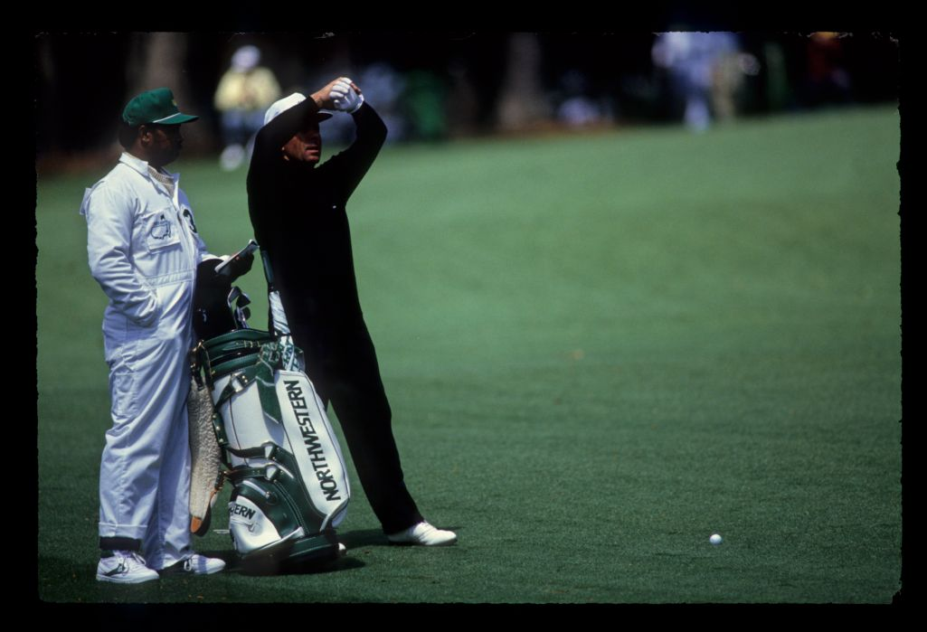 Gary Player and his caddie considering their options on the fairway during the 1989 Masters