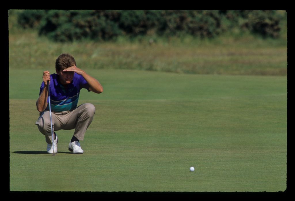 Nick Price shielding his eyes as he lines up a putt during the 1990 Open Championship