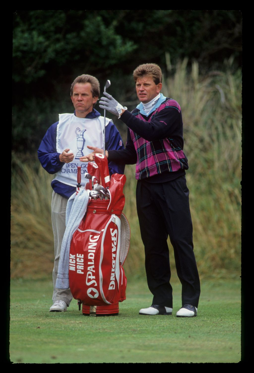 Nick Price and his caddie considering their options on the tee during the 1991 Open Championship