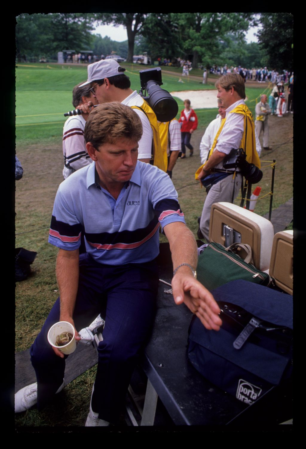Nick Price taking time out on a buggy during the 1989 US Open