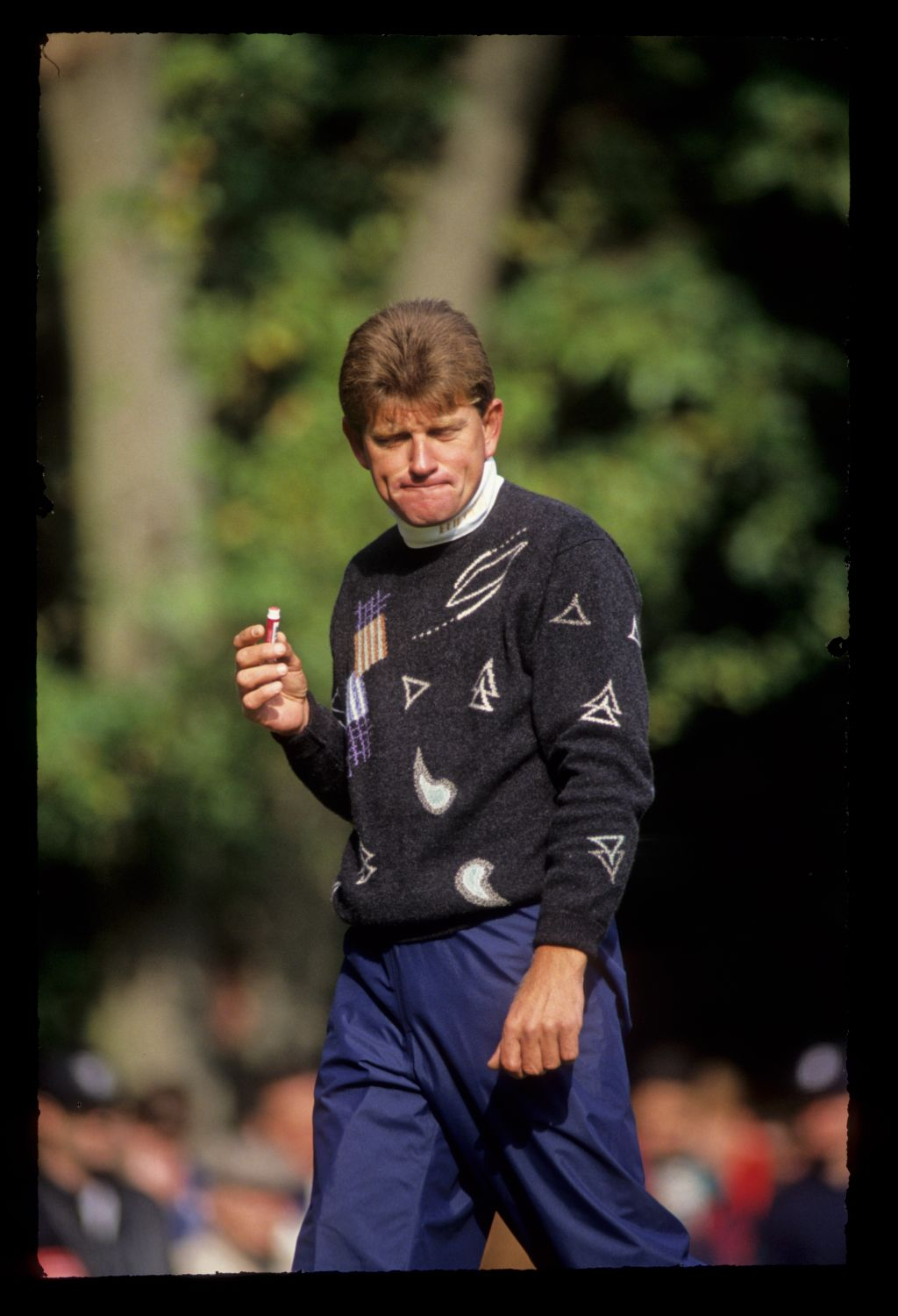 Nick Price using lip balm during the 1991 Toyota World Matchplay