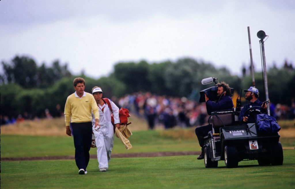 Nick Price being filmed walking the fairway on his way to second place at the 1988 Open Championship
