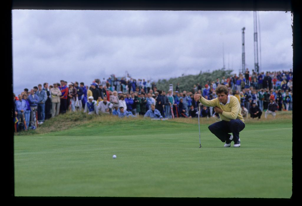 Nick Price squatting to line up a putt on his way to second place at the 1988 Open Championship