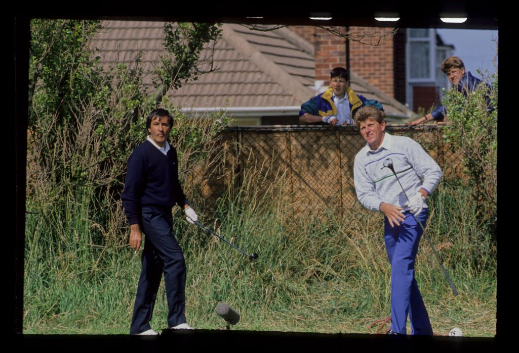Two locals watching Severiano Ballesteros and Nick Price from over the fence during the 1988 Open Championship